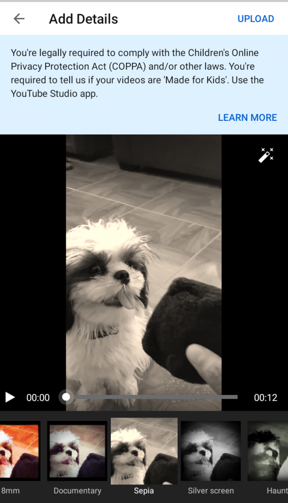 A screen shot from YouTube while enhancing a photo of a dog.
