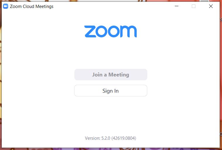 """A screenshot from the Zoom Cloud Meetings app on computer. Other than the zoom logo, it contains the words Join a Meeting and Sign In. This photo is for the """"How to Use Zoom"""" blog of TechToGraphy."""